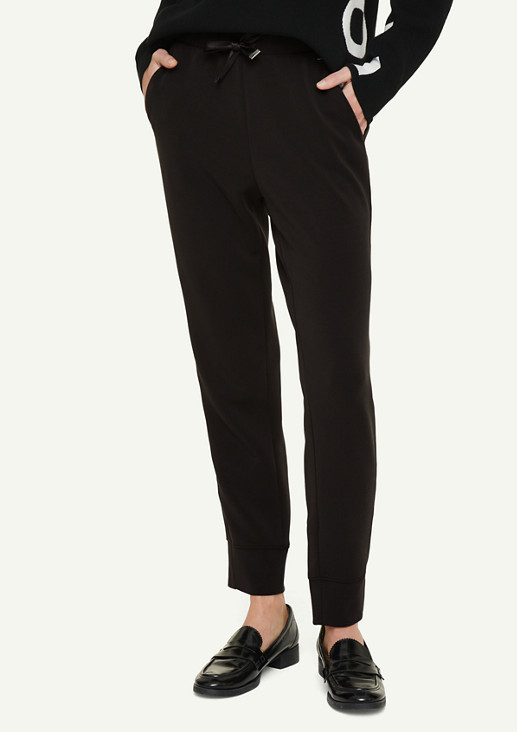 Tracksuit bottoms with satin details from comma