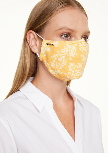 Face mask with a printed pattern from comma