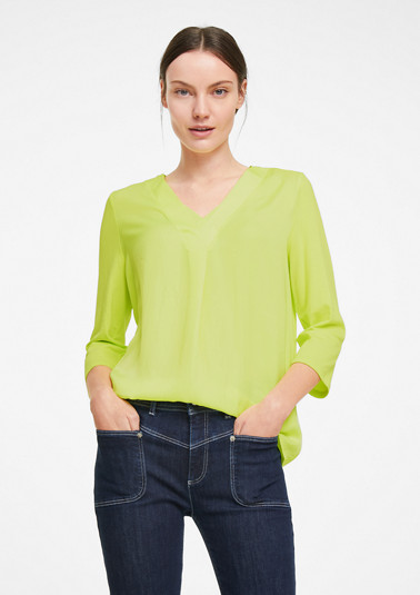 Jersey top with a blouse front from comma