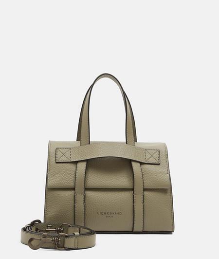 Kompakte Handtasche aus Leder mit dekorativen Riemen
