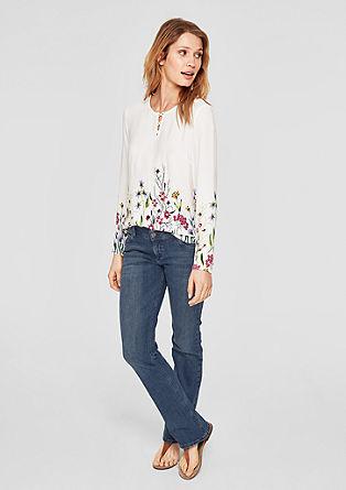 Smart bootcut: jeans met twee knopen