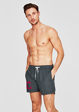 Swim shorts with a contrast appliqué from s.Oliver