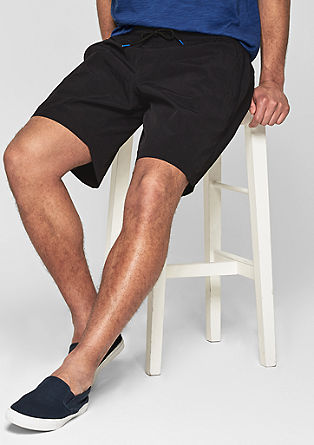 Swim shorts with a flap pocket from s.Oliver