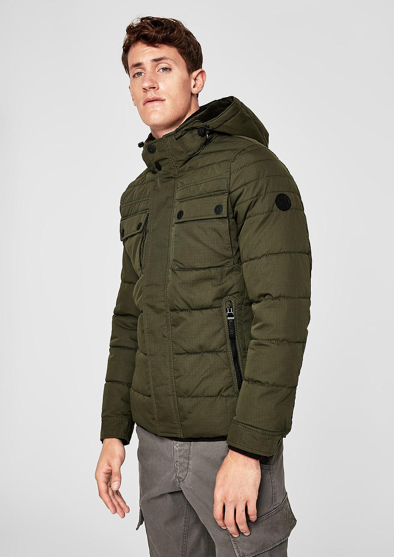 Gewatteerde winterjas in een field look