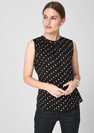 Mouwloze blouse met stippen en hoge halslijn