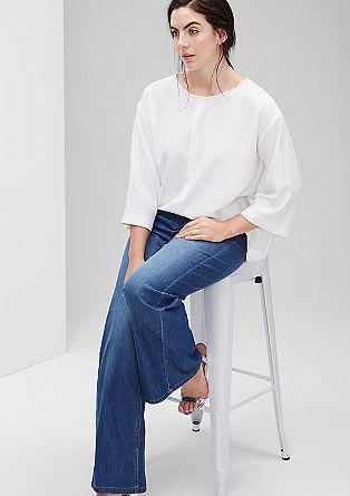 Curvy fit: Flared jeans met persplooien
