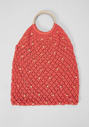 Netachtige tas met details in een houten look