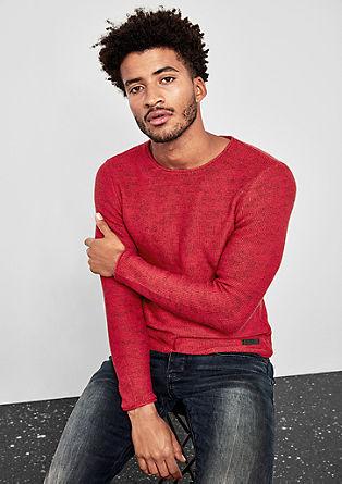 Gebreide trui met een inside-out look