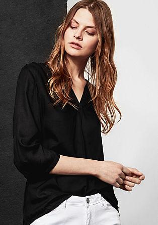 Luchtige blouse met langer achterpand