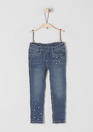 Hlačne pajkice: jeans hlače s kovicami