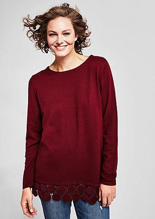Gebreide trui met een kanten sierrand