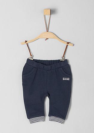 Teplákové kalhoty s proužkovanými náplety