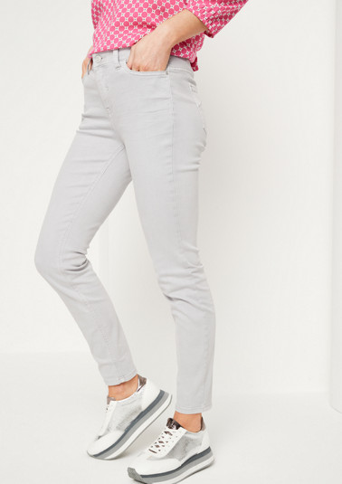 Coloured denim jeans with smart details from comma