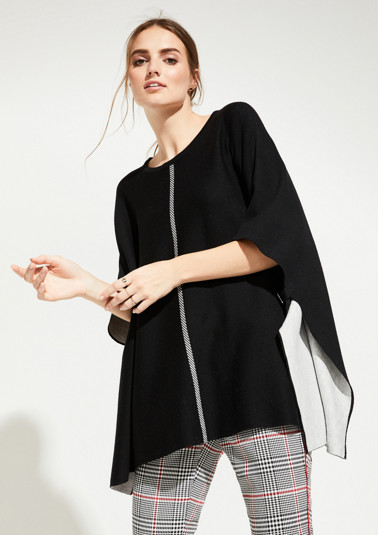 Knitted poncho with decorative details from comma