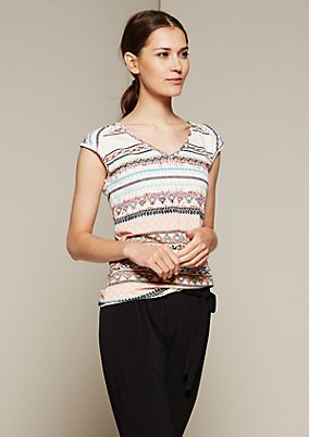 Feminine short sleeve top with a colourful all-over print from s.Oliver