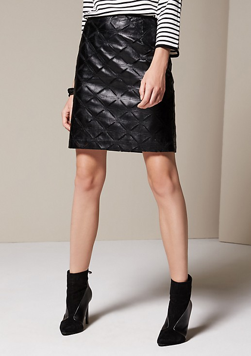 Short imitation leather skirt with an exciting minimal openwork pattern from comma