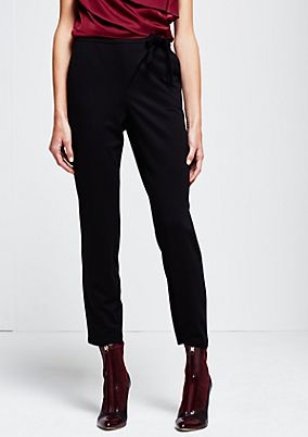 Smart jersey trousers with decorative details from s.Oliver