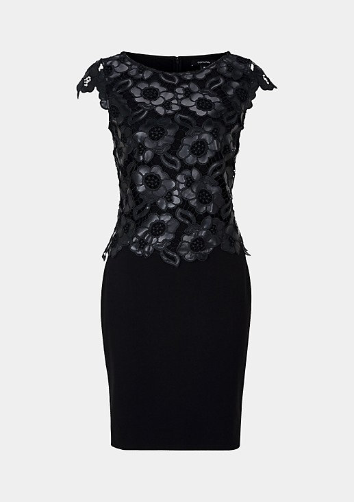 Feminine evening dress with imitation leather lace decorations from comma
