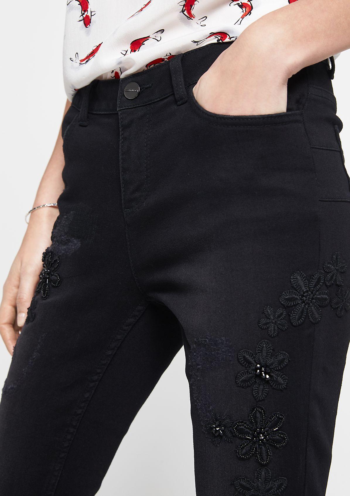 Black Denim-Jeans mit dekorativen Stickereien