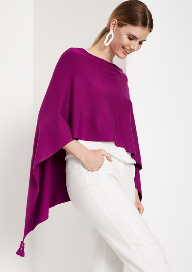 Fine knit poncho with tassel embellishments from comma