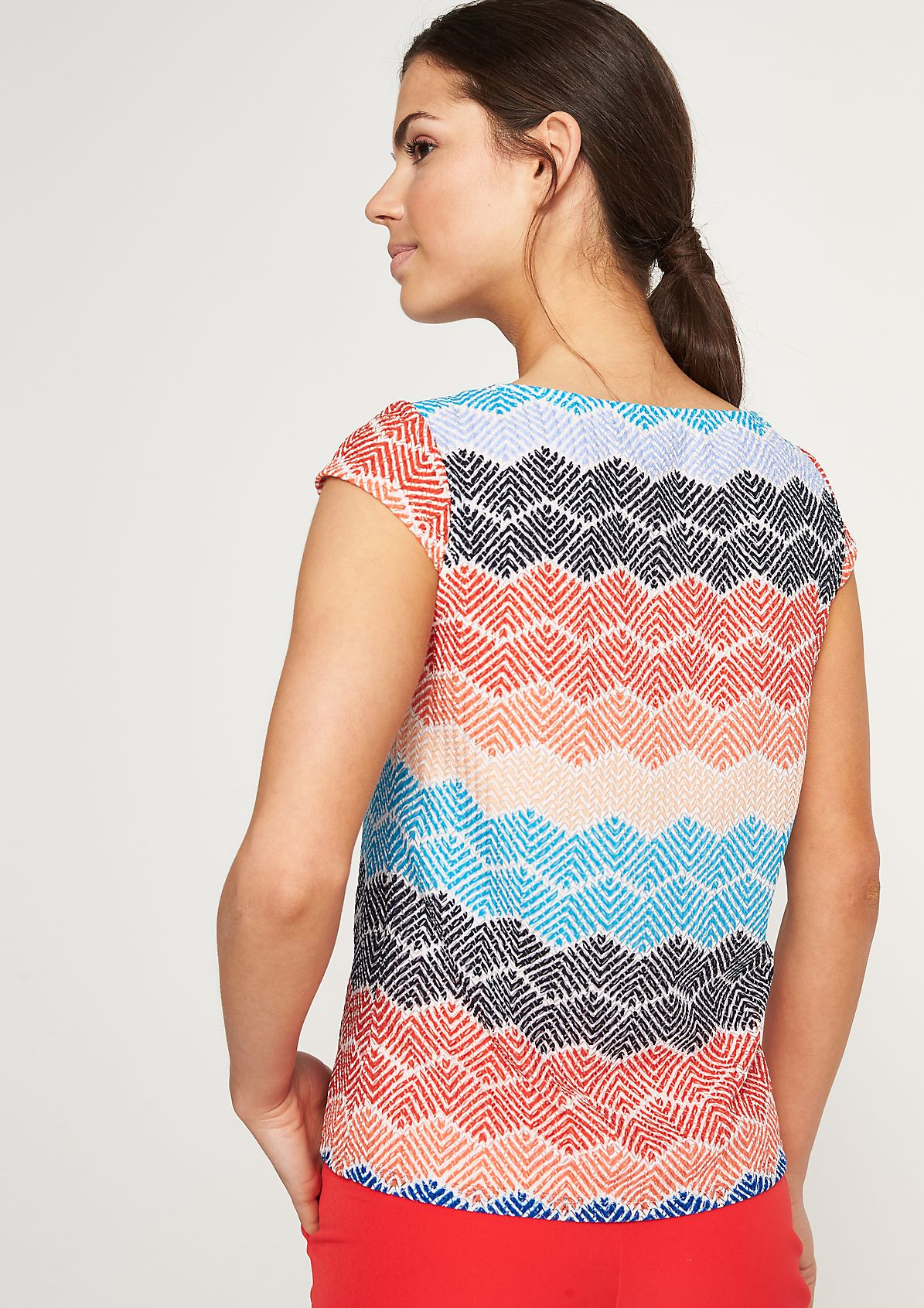 Top with a textured pattern from comma