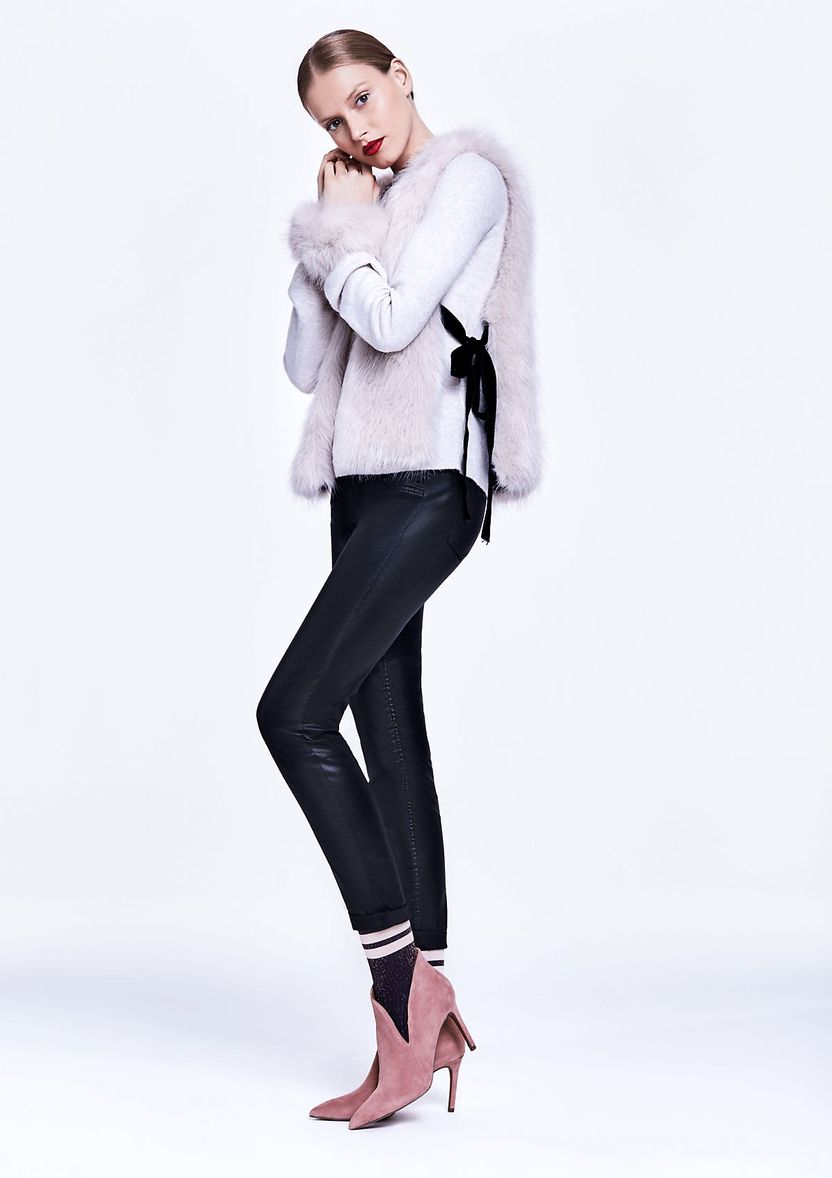 Coated faux leather trousers from comma
