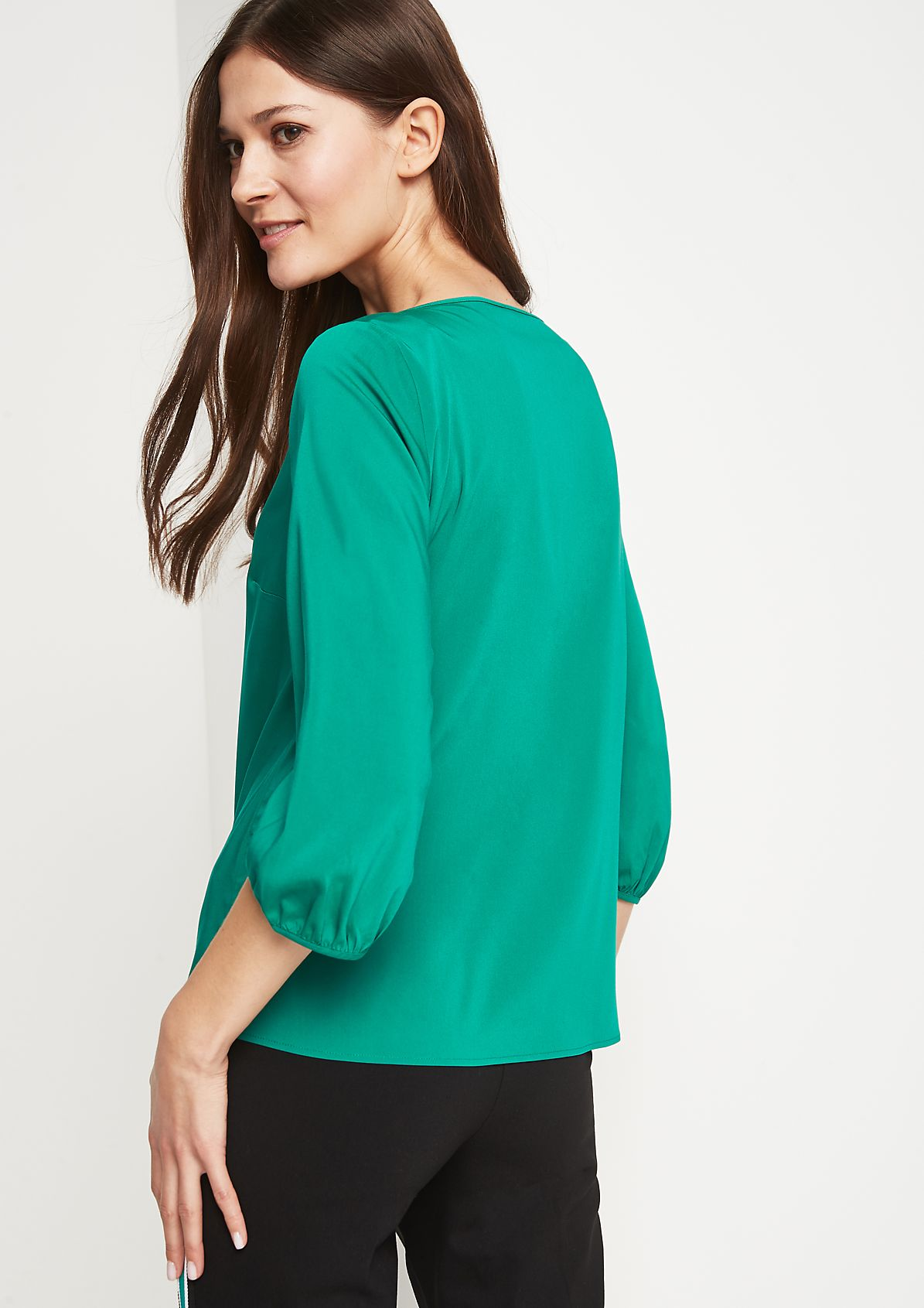 Zarte Bluse mit raffinierten Details