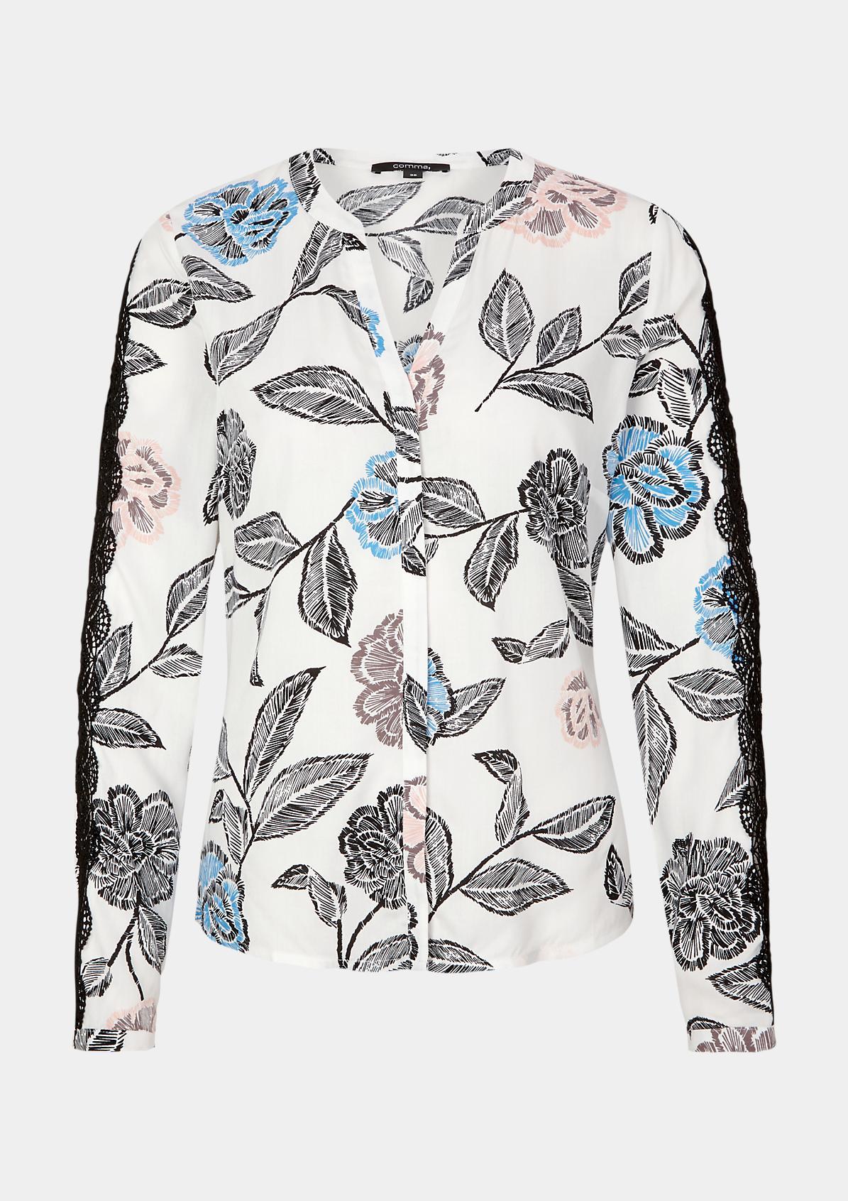 Extravagante Bluse mit Spitzenverzierungen
