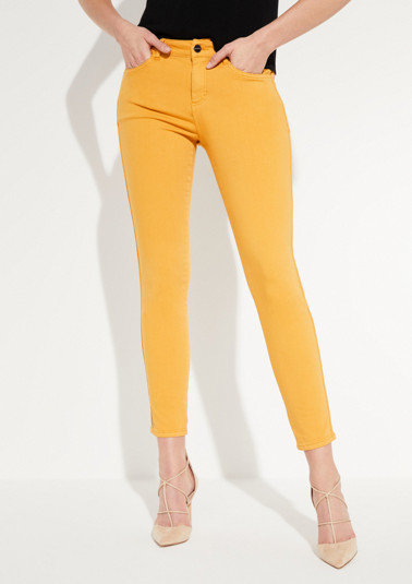 Coloured denim jeans with glittery side stripes from comma