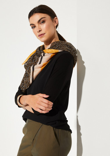 Delicate scarf in a decorative mix of patterns from comma