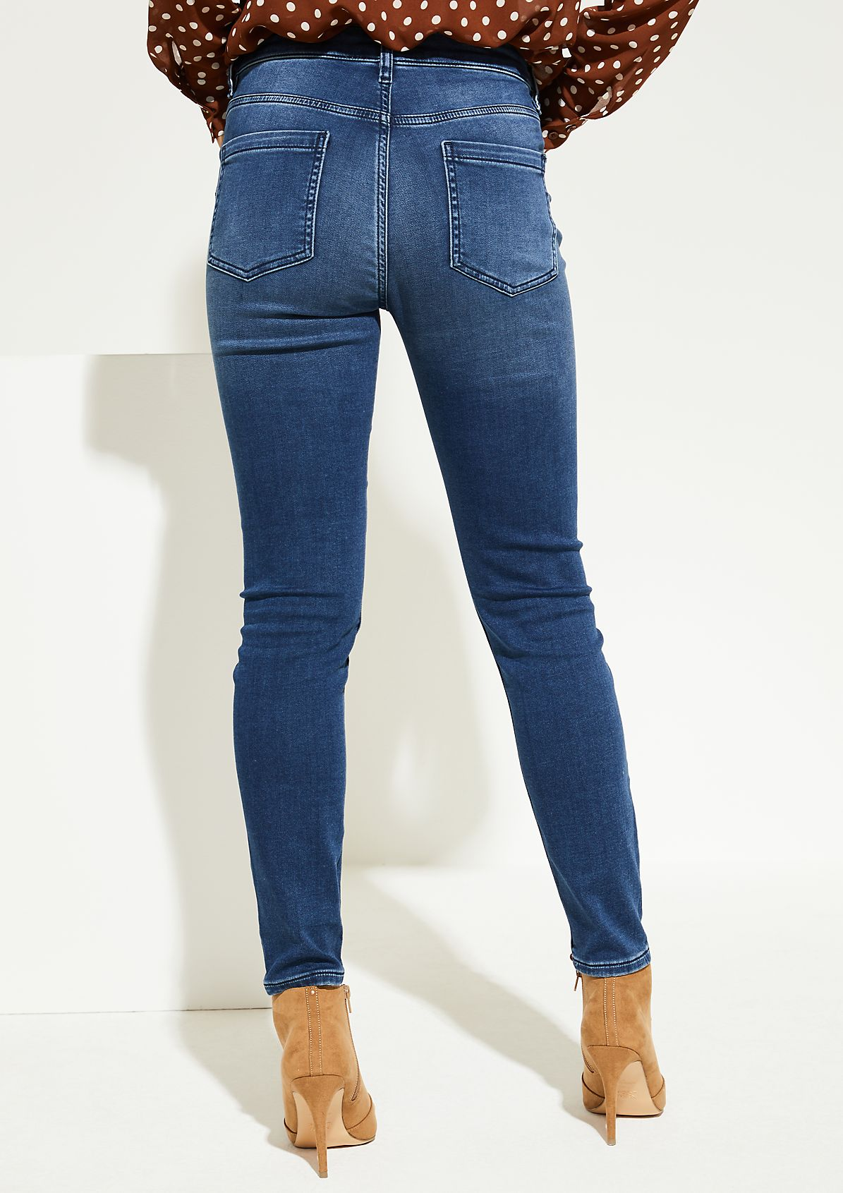 Jeans in a vintage finish with sparkly side stripes from comma