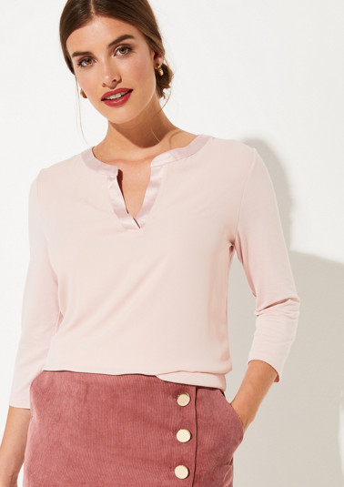 Top with 3/4-length sleeves in an exciting mix of materials from comma