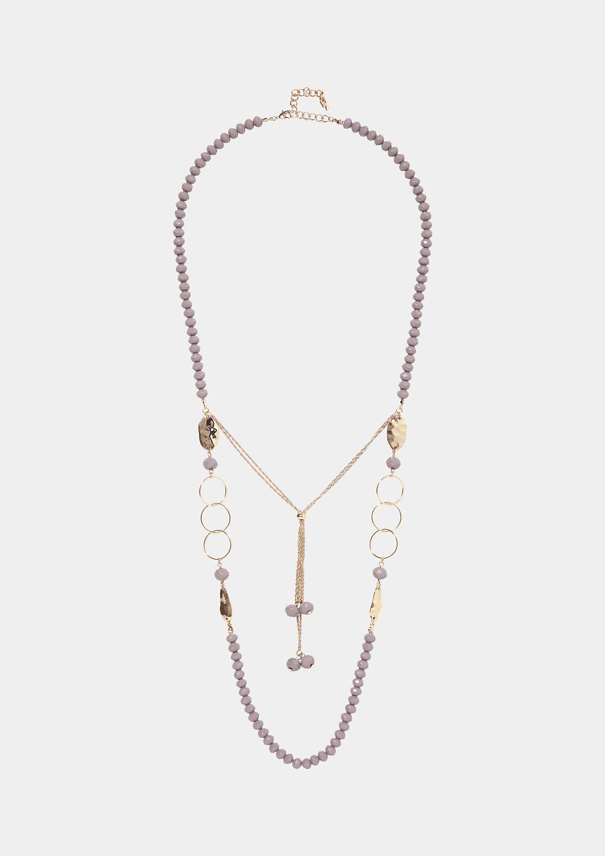 Extravagante Halskette aus Schmucksteinen mit goldglänzenden Verzierungen