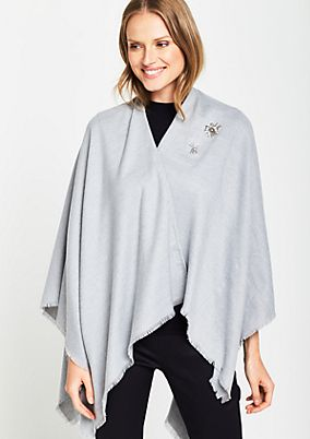 Smart knit poncho with decorative fringing from comma