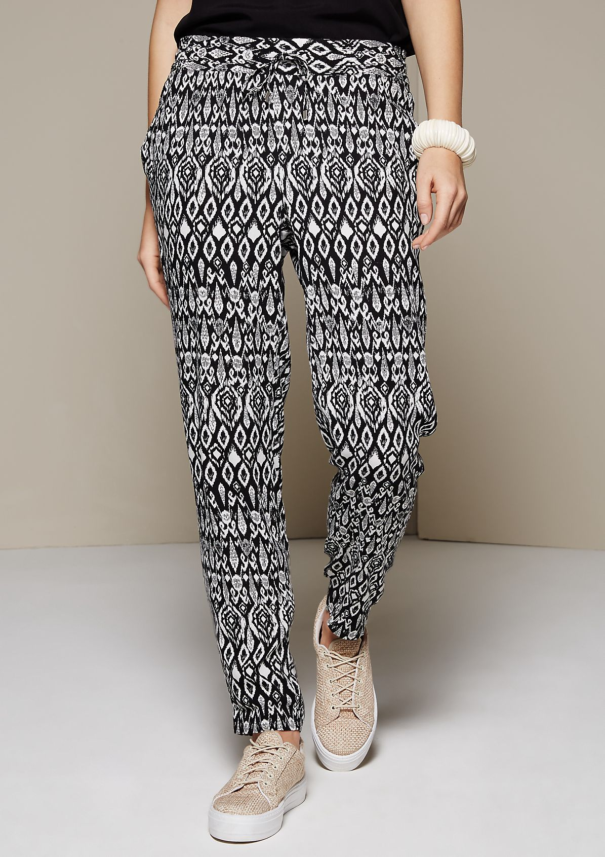 Lightweight crêpe summer trousers with an attractive all-over print from s.Oliver