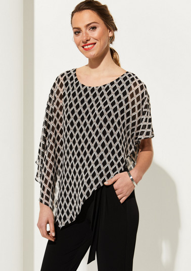 Crêpe blouse with an asymmetric cut from comma