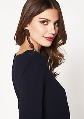 Top with 3/4-length sleeves and an exciting textured pattern from comma