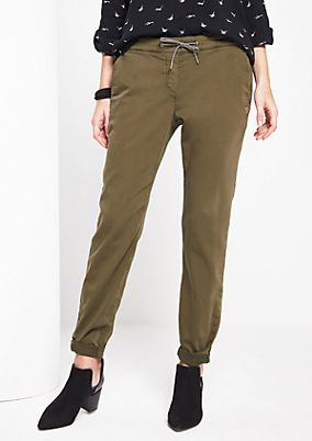 Tracksuit bottoms in an army look from comma