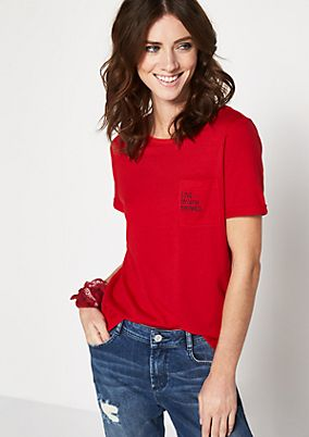 Short sleeve jersey top with a breast pocket from comma