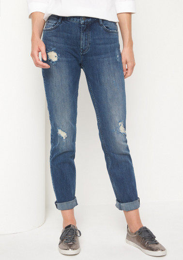 Jeans with distressed details from comma