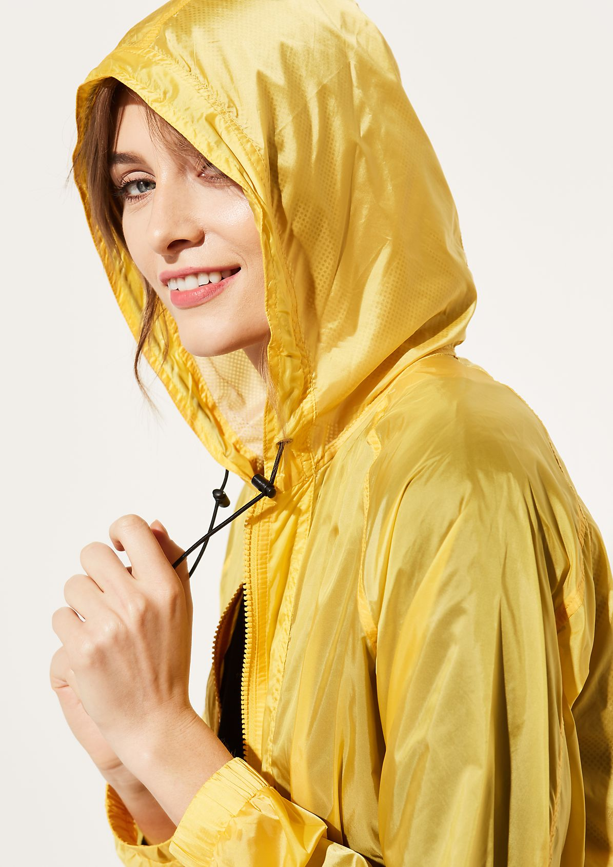 Sheer raincoat with a hood from comma