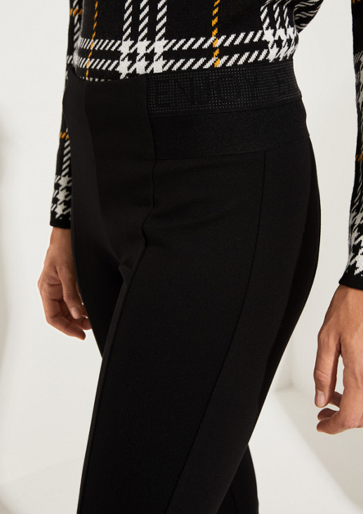 Extravagant trousers with statement on the waistband from comma