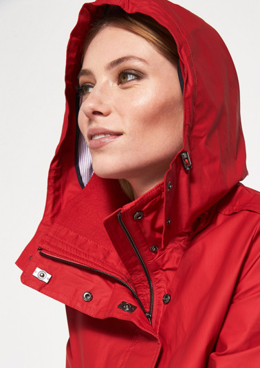 Coat with a zip-off hood from comma