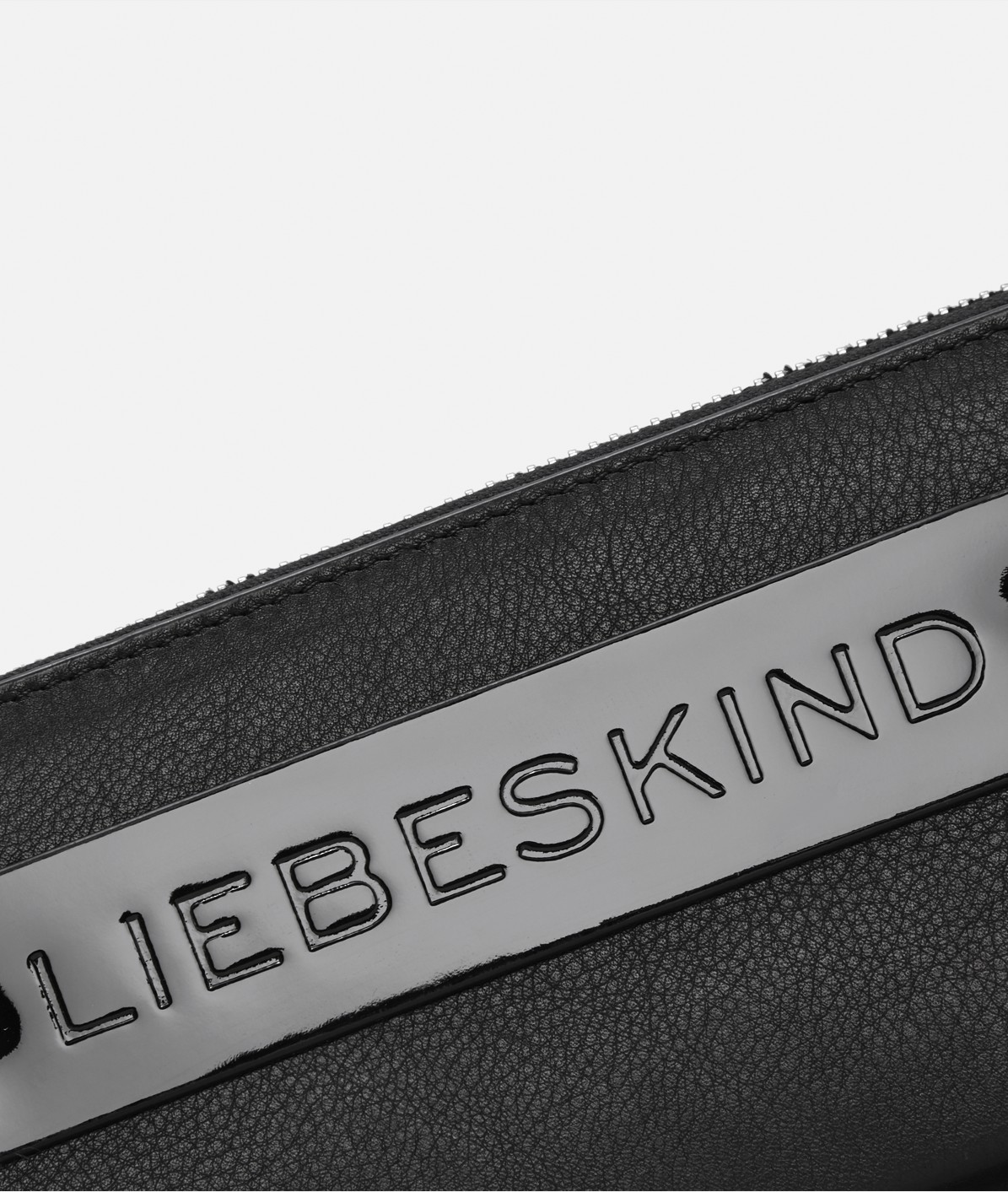 Wallet with a contrasting patent leather strap from liebeskind