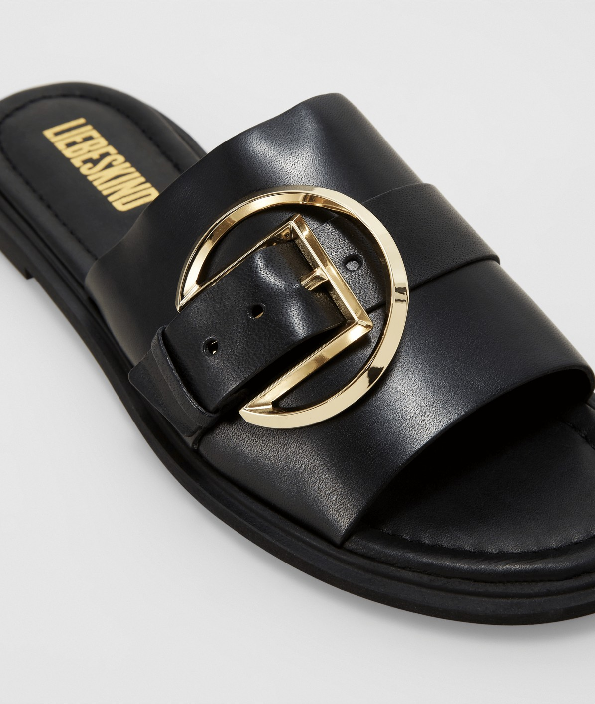 Mules with a large buckle from liebeskind